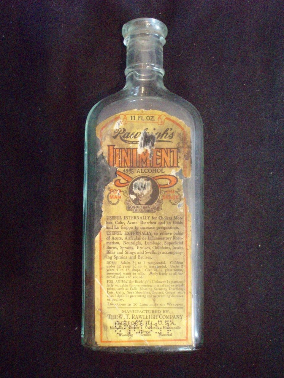 Rawleigh's Liniment Bottle w/label antique medical cure all