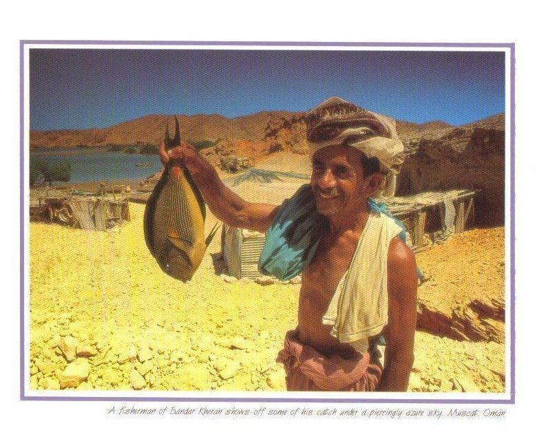 A Fisherman shows off his catch, Muscat, Oman Postcard