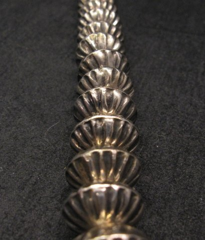 Image 6 of Orville Tsinnie Navajo Handmade Sterling Silver Stamped Fluted Bead Necklace