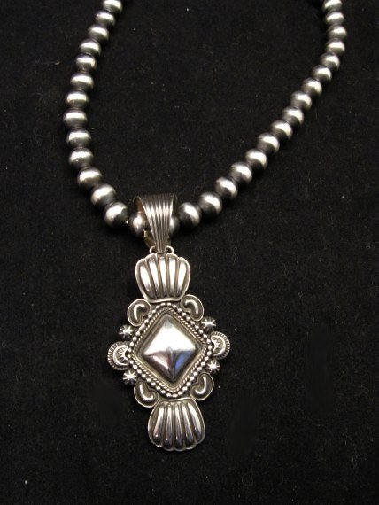 Image 1 of Navajo Native American Orville White Repousse Sterling Silver Pendant