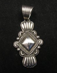 Navajo Native American Orville White Repousse Sterling Silver Pendant