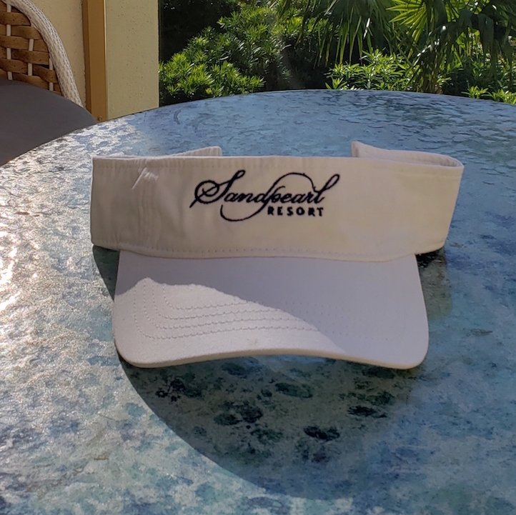 Image 0 of Visor white with embroidered Sandpearl Resort logo in navy