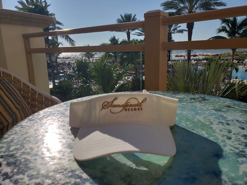 Image 1 of Visor white with embroidered Sandpearl Resort logo in gold