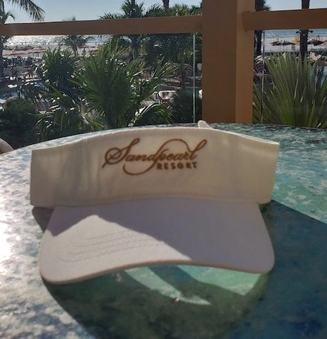 Visor white with embroidered Sandpearl Resort logo in gold