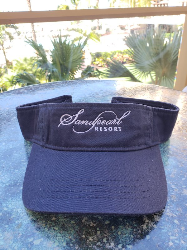 Image 1 of Visor navy with embroidered Sandpearl Resort logo in white
