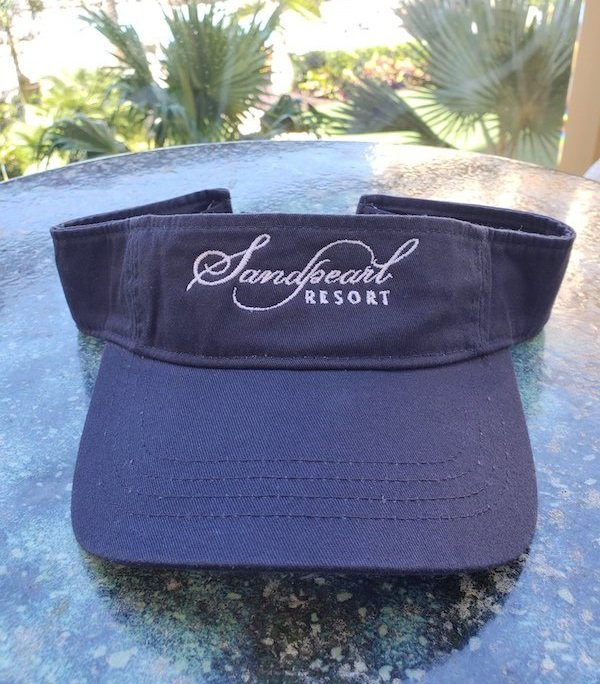 Image 0 of Visor navy with embroidered Sandpearl Resort logo in white