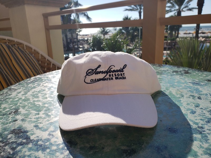 Image 1 of Hat white with embroidered Sandpearl logo in navy