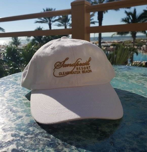 Hat white with embroidered Sandpearl Resort logo in gold