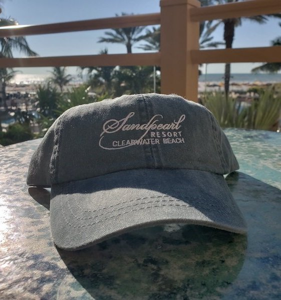 Hat weathered blue embroidered Sandpearl Resort logo in white