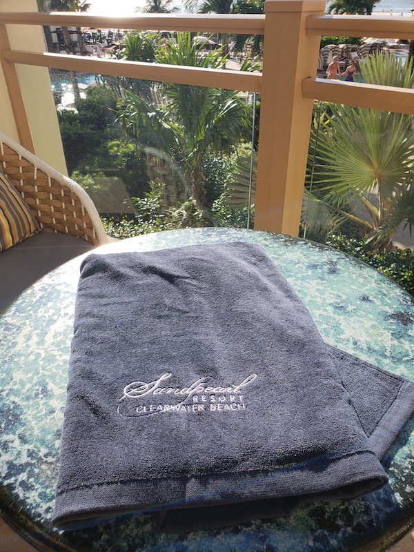 Towel navy with embroidered Sandpearl Resort logo in white
