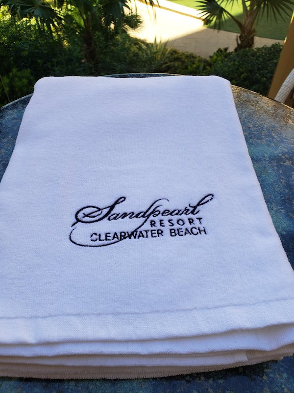 Towel white with embroidered Sandpearl Resort logo