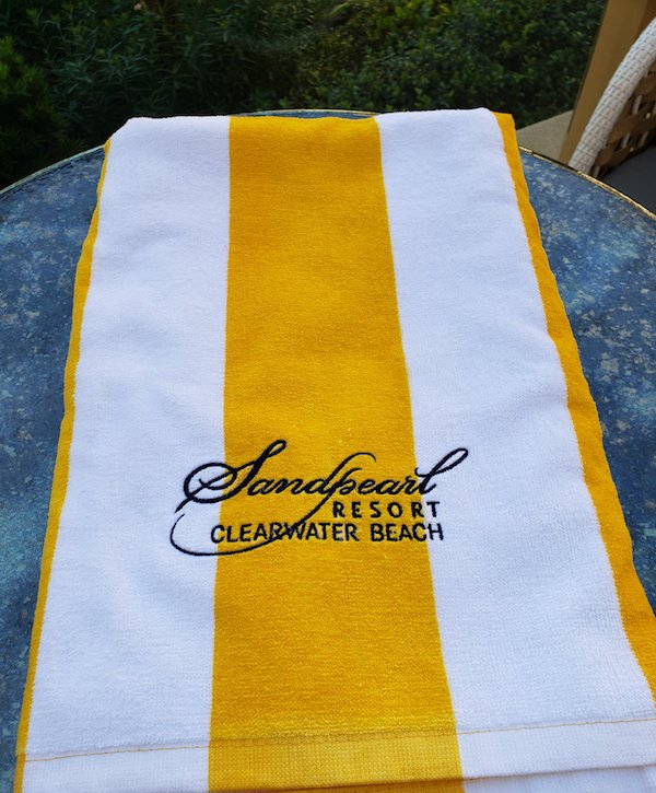Towel yellow and white embroidered Sandpearl Resort logo