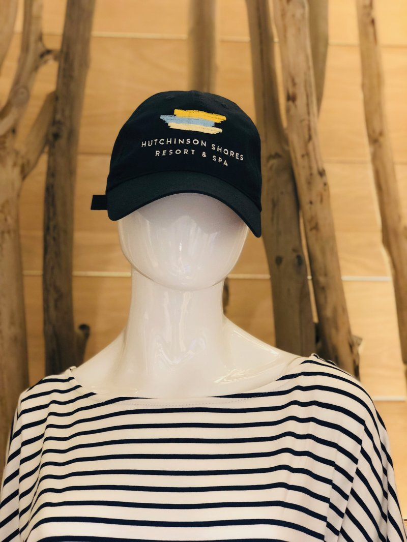 Navy blue hat with embroidered Hutchinson Shores logo