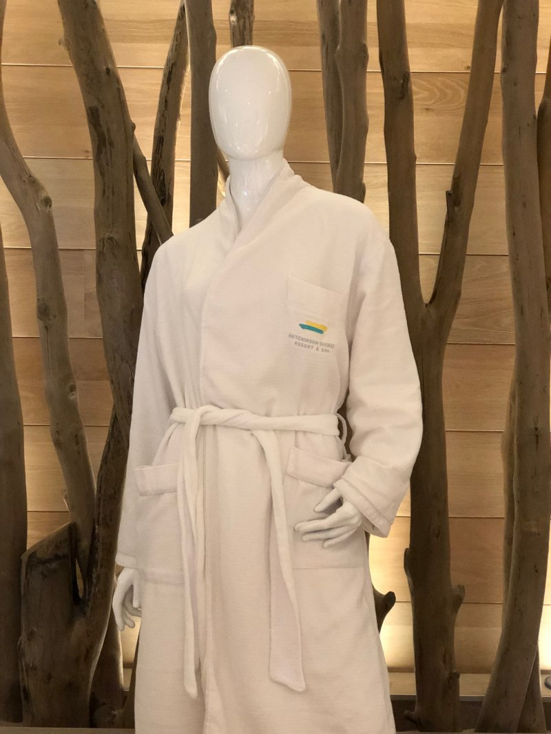White bathrobe with embroidered resort logo